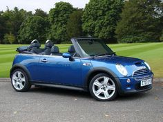 Blue convertible mini cooper...