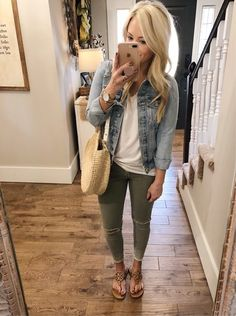 Faded jean jacket, white t-shirt, military green skinny jeans, camel TB sandals, nude handbag www.liketoknow.it/ltk/4RkVZAaGPN0a7BijKwt8bw