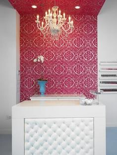 Bold design behind reception desk.