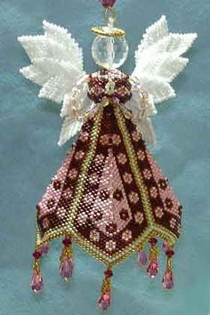 Paula Adams PETAL ANGEL ORNAMENT (Must be made using size 11 mm Japanese cylinder beads along with fancy specialty beads.) The Petal Angel features a petal skirt and beautiful feather-like wings. She is a great companion to the Majestic Angel. Beaded Christmas Decorations, Beaded Christmas Ornaments, Angel Ornaments, Christmas Angels, Handmade Christmas, Christmas Crafts, Snowman Ornaments, Felt Christmas, Beaded Ornament Covers