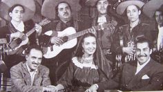 """In one of the breaks in the filming of the movie """"Enamorada"""", 1946. We see the master cinematographer Gabriel Figueroa, María Félix and the film's director Emilio """"Indio"""" Fernandez, with Mariachi Cocula."""
