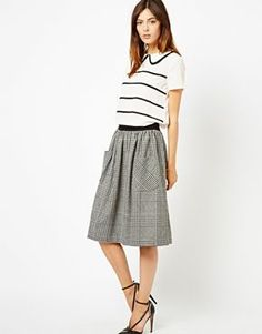 Tweed checkered skirt - such a modest length.