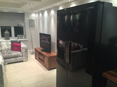 Black gloss kitchen with solid wood worktops