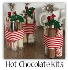 handmade christmas gift ideas - Google Search. Four vials with screw on lids. One vial for: hot cocoa, mini marshmallows, crushed peppermint candies, & chocolate spoons for stirring (?) hard to tell what the 4th item is.