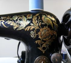 vintage Singer sewing machine with bird and leaf scroll detail