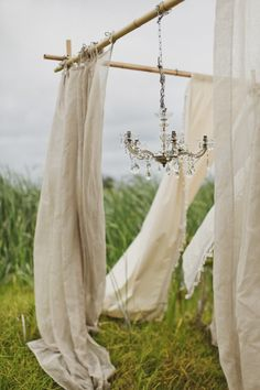 Don't have the budget for big fancy backdrops and pergolas? Make a simple frame and hang curtains and it will be just as amazing.