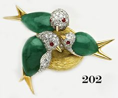 Retro Cabochon emerald, pave diamond,  ruby and gold birds in a nest brooch