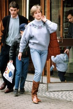 1992: Princess Diana out shopping with Prince William. Diana wearing jeans and a blue sweater, and brown/tan boots .