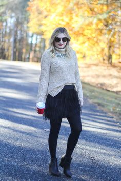 Holiday outfit, feather skirt, Christmas outfit inspiration, cable knit sweater.