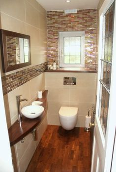 little cloakroom but wouldn't have wood in a bathroom again. Difficult to maintain. Water and soap damage happens quickly.Pretty little cloakroom but wouldn't have wood in a bathroom again. Difficult to maintain. Water and soap damage happens quickly. Small Downstairs Toilet, Small Toilet Room, Downstairs Cloakroom, Small Bathroom, Bathroom Ideas, Cloakroom Ideas Small, Bathroom Remodeling, Cloakroom Sink, Bathroom Hacks