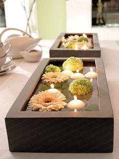 Свечи в воде с цветами