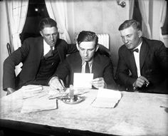 Chicago White Sox players Charles 'Swede' Risberg, left, and Oscar 'Happy' Felsch, right, with Attorney Ray Cannon, middle, during the 1921 Black Sox trial