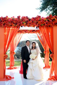 Love the colors and how vibrant they are in this orange chuppah