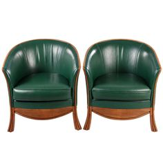 These lovely, and extremely comfortable, Art Deco-style green leather chairs were custom-made by Rosello of Paris for a hotel in the South of France, circa 1950s. Rosello has been manufacturing retail and custom furniture since the 1930s, and has become synonymous with luxury. We were told that these chairs were from a hotel lobby in France, and that only 60 of this particular model had been made. Very stylish armchairs with beech wood rounded backs, curved saber legs and demilune aprons.