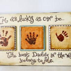 best daddy in the world belongs to me; scrapbook paper hand prints, scrapbook paper, modge podge; mounted onto wood