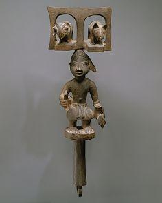 Sango Staff: Male Figure (Ose Sango) Artist: Duga of Meko Date: ca. 1880–1960 Geography: Nigeria, Ketu region, Meko Culture: Yoruba peoples Medium: Wood, pigment Dimensions: H. 15 3/8 x W. 5 1/4 x D. 3 1/8 in. (39.1 x 13.3 x 7.9 cm)