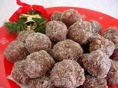Christmas Rum Balls (Or Bourbon Balls)  Quick and Easy No Baking Required! My kind of recipe.  INGREDIENTS  Makes 24  2 1⁄2 cups vanilla wafers, crushed (a 250g box of Christies vanilla wafers equals 2 1/2 cups) 2 tablespoons cocoa 1 1⁄4 cups icing sugar 1⁄2 cup spiced rum (the rum is called Spiced Rum) or 1⁄2 cup Bourbon 2 tablespoons white corn syrup (one brand is Karo) 1 cup pecans or 1 cup walnuts, broken  DIRECTIONS  Sift the cocoa with 1 cup sugar. Stir in the spiced rum mixed with…