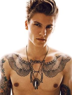 there is just something about guys with tattoos and piercings that sets my heart…