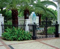 Stewart Iron Works Custom Fence | A custom pool fence and complementing drive gates in wrought steel and cast iron