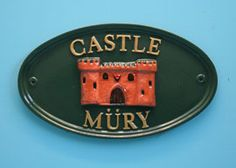 """Oval 12"""" x 7"""" house sign in racing green with hand painted gold letters and castle motif.    Sent to Switzerland.  www.rockartisansigns.co.uk"""