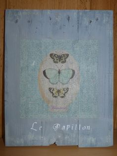 Cuadro realizado con maderas de palet, decorado con decoupage y estarcido