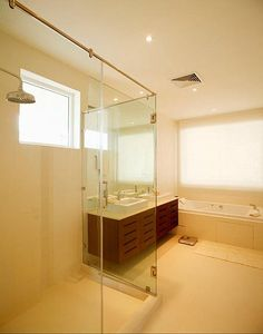 Master Bathroom with Jacuzzi Bath, huge walk in shower and separate Toilet