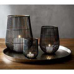 Sale ends soon. Delicate wire cage shelters candles in two-toned iron. Black exterior accentuates the delicate silhouette, while gold interior enhances candlelight's glow. Candle Tray, Large Candle Holders, Hurricane Candle Holders, Candle Holder Decor, Candle Lanterns, Votive Candles, Outdoor Candle Holders, Black Candles, Tea Light Candles