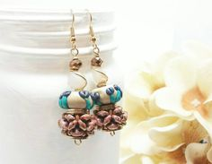 Check out this item in my Etsy shop https://www.etsy.com/listing/274220010/long-gold-earrings-flower-beaded