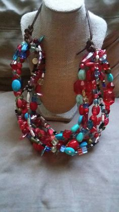 Check out this item in my Etsy shop https://www.etsy.com/listing/475194230/red-and-teal-bold-beaded-bib-necklace-on
