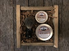 Guys shave kit with a badger hair shave brush, goat milk shave soap, coconut oil aftershave in a handmade reclaimed wood box.