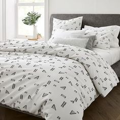 What we love about our Mini Graphic Geo Duvet Cover is that it makes a statement but doesn't overpower the room. Made from organic cotton, little geometric shapes with fringe detailing dance over a crisp white background for a playfully moder… Find Furniture, Furniture Decor, Outdoor Furniture, Expandable Dining Table, Beds For Sale, Bed Duvet Covers, Cotton Duvet, West Elm, Interior