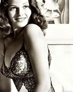 Rita Hayworth...classic!! How many GI's from WWII went to bed with this image in his head? :)