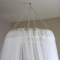 DIY Canopy $8.00 using embroidery hoop and sheer IKEA curtains... inspired by http://roomenvy.wordpress.com/2010/03/11/girls-bedroom-wallpaper/