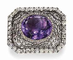 A GOLD AND SILVER-MOUNTED DIAMOND AND AMETHYST CENTREPIECE PROBABLY BY FABERGÉ, ST PETERSBURG, CIRCA 1890. Shaped rectangular, the centre set with an oval-cut amethyst, within a concentric openwork scrolling foliate border set with rose-cut diamonds.