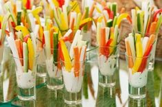 What a fun and festive way to serve veggies!  Cut the veggies like matchsticks and insert into the glasses with ranch dressing.  Add a sprig of chive to liven it up!