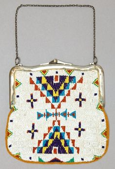 A SIOUX BEADED HIDE PURSE c. 1900 thread sewn and lane-stitched in various shades of glass seed beads, one - Available at 2012 May 5 Signature American. Indian Beadwork, Native Beadwork, Native American Beadwork, Native American Jewelry, Native American Artifacts, Native American Tribes, Beaded Purses, Beaded Bags, Native Design
