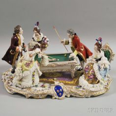 German Porcelain Plateau of a Gaming Scene, 20th century, depicting pool players, on a gilt-decorated plateau with central molded cartouche