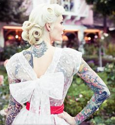 I don't particularly like her dress - the bow is gaudy in a bad way - but the splash of color is nice, and it's rare to see a tattooed bride.