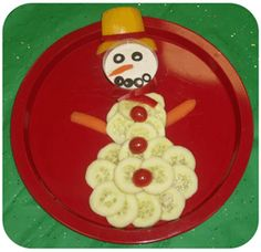 "Snowman Snacking! Not exactly a gift, but certainly a cheery snack to offer to bring to a holiday party. The ""face"" holds the dip."