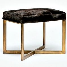 With dark brown cowhide sitting atop a brass frame, the Small Roger Bench from Made Goods brings an upscale, sophistication to seating. The aged-brass base has a minimalist feel while the Brazilian hair-on-hide top adds a natural element.