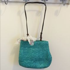Adorable Turquoise Woven Summer Shoulder Purse Brand new! Has beaded detail on straps and adorable polka dotted tie bow:) bought from a boutique in raleigh Boutique Bags Shoulder Bags