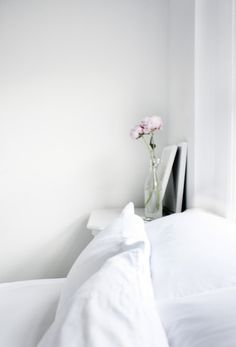 white + flowers in a minimalist bedroom