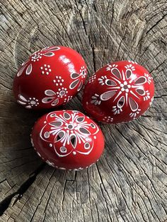 Red Hand painted Easter eggs with a ribbon. This is a set of 3 red chicken eggs approximately the same size, painted colors and decorated with wax. The eggs are decorated using a wax pinhead and is the oldest and most widely used technique. The tradition of painted eggs back to the depths