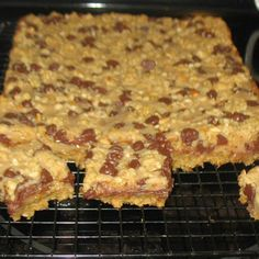 Chocolate Peanut Butter Bars - 2 cups quick-cooking oats + 1¾ cups firmly packed light brown sugar + 1½ cups flour + 1 tsp baking powder + ½ tsp baking soda + 1 cup butter + ½ cup chopped peanuts + 1 cup (6 oz. pkg) semi-sweet chocolate chips + 1 large egg, beaten + 1 (14 oz) can condensed milk + ½ cup creamy peanut butter