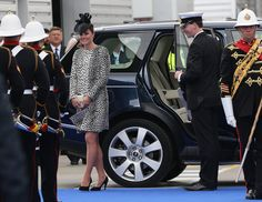 Kate Middleton Makes a Smashing Final Appearance Before Leave: Kate Middleton wore a leopard frock for her last solo appearance.   : Kate Middleton smoothed her hair down.  : Kate Middleton arrived at her last solo appearance before her maternity leave.