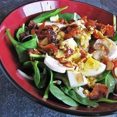 Spinach salad with warm bacon mustard dressing. Everyone loves it.