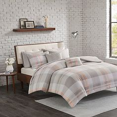 Bring chic style to your bedroom with the Madison Park Westin Flannel Reversible Comforter Set. Decked out in a classic plaid print in soothing grey and blush hues, the cozy flannel bedding adds a touch of charm to any room's décor.
