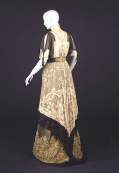 """Evening gown, House of Worth, ca. 1912. """"Note the absence of the severe corseted 'S' shape and the way this gown, with its columnar form, falls softly from the shoulders."""""""