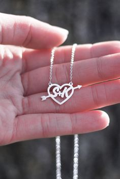 A necklace that's all about true love! Personalize this heart arrow pendant with the initials of you and the one you love to create a one-of-a-kind piece.