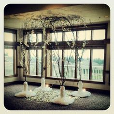 This beautiful wintry indoor ceremony alter from a recent TPC wedding was done by our friends at Laurel's Floral Decor.